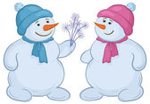 Snowmens with snowy flowers — Stock Photo