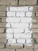 Parede de tijolos cinza com retângulo pintado branco — Foto Stock