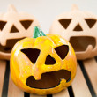 Ceramic candlestick: Halloween pumpkin face — Stock Photo
