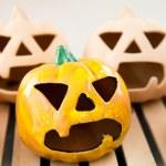 Ceramic candlestick: Halloween pumpkin face — Stock Photo