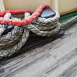 Bundle of rope on the mooring bollard — Stock Photo #7321333
