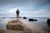 A man on the old broken pier — Stock Photo