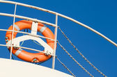 Lifebuoy on the naval railing — Stock Photo
