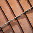 Stock Photo: Naval rope above wooden hull