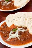 Beef goulash and dumplings — Stock Photo