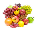 Still life of fruit in a wicker basket on a white background — Stock Photo