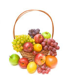 Set fruit in a wicker basket on a white background — Stock Photo