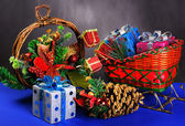Sledge with gifts and garland — Stock Photo