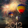 Stock Photo: New year 2012 fireworks and hot air-balloon