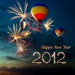 New year 2012 fireworks and hot air-balloon at sunset — Stock Photo