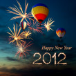 Stock Photo: New year 2012 fireworks and hot air-balloon at sunset