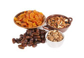 Dried fruits in vases — Stock Photo