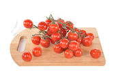 Branches with tomatoes on a board — Stock Photo