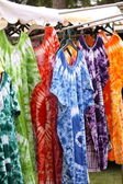 African dresses colored on a market for the sale — Foto de Stock