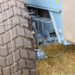 Shock absorber and tire of large farm trailer — Foto Stock #6917983
