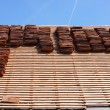 Renovation of a tiled roof of an old house - Stock Photo
