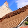 Renovation of a tiled roof of an old house — 图库照片