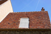 Renovation of a tiled roof of an old house — Stock Photo