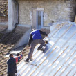 Foto de Stock  : Roofer working on new roof in wood