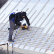 Roofer working on a new roof in wood — Stock Photo #7470227