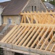 Stock Photo: Construction of the wooden frame of a roof