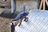 Roofer working on a new roof in wood — Stock Photo