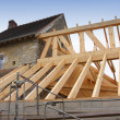 Construction of the wooden frame of a roof - Stock Photo