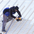 Roofer working on a new roof in wood — Stock Photo #7586212