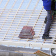 Roofer working on a new roof in wood -  