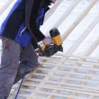 Roofer working on a new roof in wood — Stock Photo #7586259