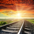 Stock Photo: Railroad to red sunset