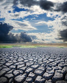 Dry lake and dramatic sky — Stock Photo