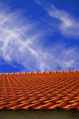 Red Tile Roof Under Blue Sky — Stock Photo