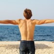 Man's back on the beach, freedom, success — Stock Photo #6967720