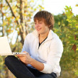 Happy man work at the laptop, outdoors autumn — Stock Photo #6967741
