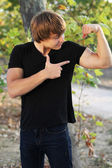 Sport man display strong hands. Fit muscular young male — Stock Photo