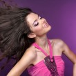 Young happy Beautiful girl dancing in disco-light — Stock Photo