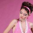 Beautiful woman with make-up and hair style over pink — Stock Photo