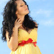 Portrait of Beautiful pregnant woman over sky — Stock Photo