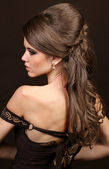 Beautiful woman with hairstyle luxuriant long hair. Beauty. Long — Stock Photo