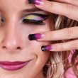Fashion multicolored make-up and beauty purple manicure of finge — Stock Photo