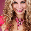 Happy smiling belly dancer girl with curly blond hair over ping — Stock Photo #7518327