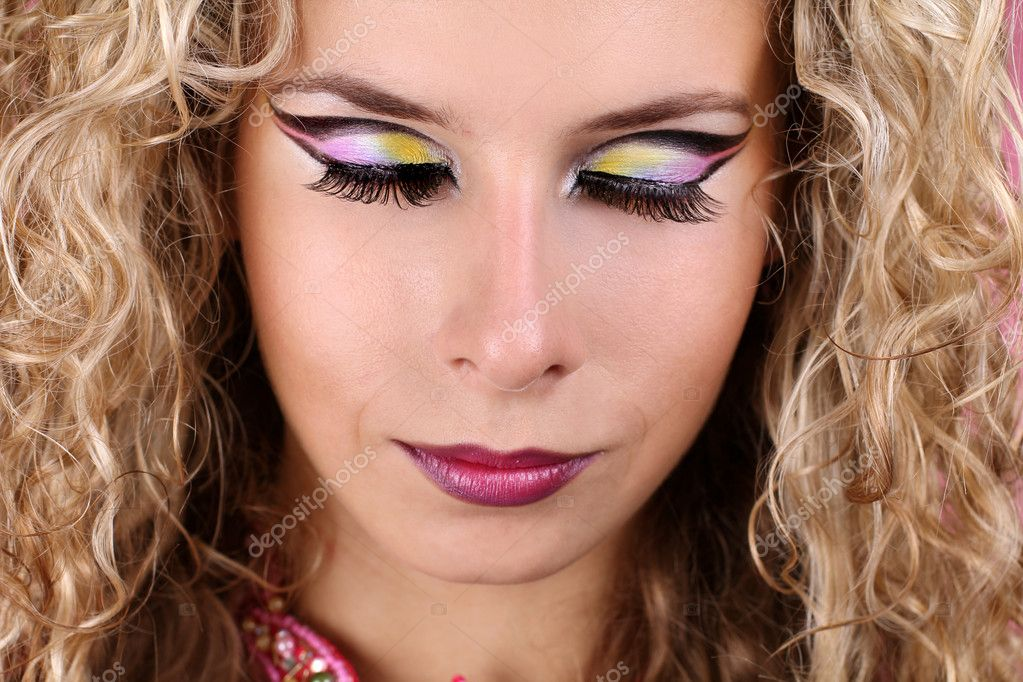 Woman with makeup  shadow-eyes and blonde curly hair — Stock Photo #7518451