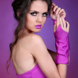 Young beauty woman portrait on bright purple background — Stock Photo #7761398