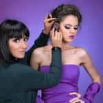 Professional Make-up artist doing model makeup at work — Stock Photo #7761406