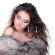 Attractive fashion woman in fur coat with make up — Stock Photo #7954157