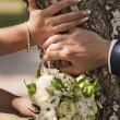 Wedding bouquet and hands with rings - Photo