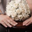 Wedding bouquet and hands with rings - Stock Photo