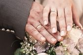Hands with rings of married woman and man — Stock Photo