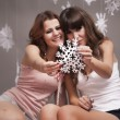 Girls and snowflakes - Stok fotoğraf